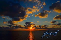 ROO_9379 (frankiejeanie) Tags: ocean morning sunset sea sky sun reflection clouds sunrise nikon pacific earlymorning bluesky s calm pacificocean sunrays cloudporn sevenseas darkbluesky orangeclouds sunbehindclouds nikonphotography d7000 nikond7000