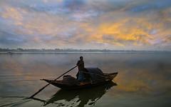A Golden Dawn (Chiradeep.) Tags: sky india reflection sunrise river dawn boat fisherman fishingboat kolkata calcutta ganga ganges westbengal