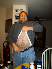 Christmas 2009 (arterial spray) Tags: christmas portrait tattoo canon monkey funny bad stomach gross kansas bellybutton butthole sailorjerry stretchmark dalliswillard