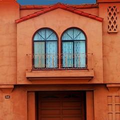 face off (msdonnalee) Tags: orange house window architecture facade ventana casa dom fenster garage haus janela maison fachada fentre faade stucco facciate orangestucco