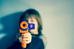 gun (instagram asier.mateus) Tags: boy playing game toy 50mm nikon gun child shot kind 18 juego niño spiel junge juguete disparo jugando arma shotting d3100