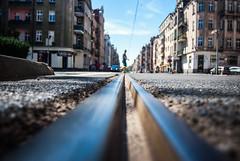 glide (ewitsoe) Tags: man walking narrow focus rails low dof nikon d80 2035mm street urban city citylife transit ewitsoe wilda moment summer polska europe train tracks