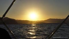 Sailing Past The Sun (Sailor Alex) Tags: boat sailboat sloop vessel sardinia yachting cruising cruisers yacht sea sailing