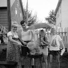 Not even the pouring rain would stop my dad from barbecuing! Cooking up some chicken and ribs. My mom, dad, sis and one of  her best friends. Milford Connecticut. August 1972 (wavz13) Tags: oldphotographs oldphotos 1960sphotographs 1960sphotos oldphotography 1960sphotography vintagesnapshots oldsnapshots vintagephotographs vintagephotos vintagephotography vintagemilford oldmilford vintagewoodmont oldwoodmont 1970smilford 1970swoodmont connecticutphotographs connecticutphotos oldconnecticutphotography oldconnecticutphotos oldconnecticut vintageconnecticut connecticutphotography vintagenewengland oldnewengland 1970snewengland vintagenewenglandphotography oldnewenglandphotography vintagenewenglandphotos oldnewenglandphotos oldfamilyphotos vintagefamilyphotos oldfamilyphotography vintagefamilyphotography 126 126film squareformat instamatic verichromepan grain grainy analogphotography filmphotography vintagekids vintagechildren vintageteens vintageteenagers teenmemories teenagememories vintageteengirls vintageteenagegirls female longhair oldclothes vintageclothes oldclothing vintageclothing instamatic104 kodakinstamatic104