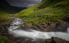 The Hall Of The Mountain King (Nigel Jones LRPS) Tags: light sky sunlight mountains green water grass norway danger river landscape threatening norwegian stormclouds rushing grieg myrkdalen