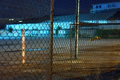 (geo_hill) Tags: urban night fence lowlight pattern repetition coathanger barrier afterdark wasteland