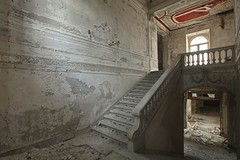 Crimson Halo (earthmagnified) Tags: red urban abandoned crimson stairs panel decay decorative exploring explorer columns decoration palace plaster stairwell ceiling stairway landing villa marble banister railing exploration palazzo abandonment stucco chateaux crumbling ue urbex collapsing