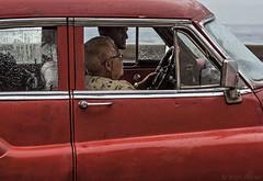 Driving Ms. Cuba (Mitch Ridder Photography) Tags: approved cuba havanacuba islandofcuba cuban caribbean largestcaribbeanisland island havana capitol rain rainyday rainphotography streetphotography workshop photoworkshop travelphotography cameravoyages mitchridder mitchridderphotography mitchridderphotographyallrightsreserved2016 classiccar americanclassiccar redcar malecon