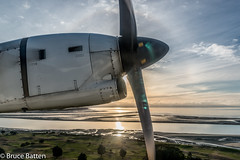 160802 NSN-AKL-04.jpg (Bruce Batten) Tags: vehicles aircraft plants halos subjects reflections cloudssky atmosphericphenomena aerial businessresearchtrips sun locations newzealand trips occasions celestialobjects shadows trees glitter southpacificocean tasmansea oceansbeaches airplanes