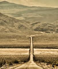 IT'S ALL UPHILL, UNLESS IT'S DOWNHILL (Irene2727) Tags: deathvalley california road hill mountain mountainscape vertical landscape scape sepia monochrome desert desertscape