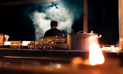 Open Kitchen (Valentina White) Tags: medieval medievalfestival sicily sicilia italy italia canon canonphotography openkitchen open kitchen cooking scene dailylife daily life fire candle smoke lit candlelit naturallight natural light shadow night photography nightphotography valentina bianco valentinabianco valentinabiancophotography white valentinawhite valentinawhitephotography back frombehind portrait spontaneous spontaneousportrait casual random tradition root usi usicostumi usanze places exploring throughthelens