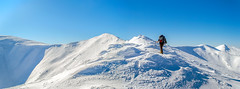 Tourist on a snowy ridge (oleksandr.mazur) Tags: afternoon alpinist backpack clear environment extreme gear high hiking ice icecap landscape light man mountain nature one path peak people ridge sky snow sunlight sunny top tourism tourist travel trekking view wide winter