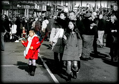 Red for luck (* RICHARD M (Over 5 million views)) Tags: street candids crowds chinesenewyear kungheifatchoi chinatown liverpoolschinatown liverpool merseyside multiculturalmerseyside multiculturism liverpoolchinese liverpudlians chineseliverpudlians scousers chinesescousers scousechinese liverpudlianchinese red luckyred selectivecolour families happyfamiles happy happiness celebrations february winter winterclothing wrappedupwarm keepingwarm stayingwarm wellwrappedup shadows pointing