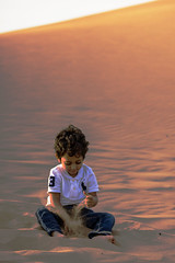 Khalid playing with sand (haidarism (Ahmed Alhaidari)) Tags: playing love children fun sand dune khalid