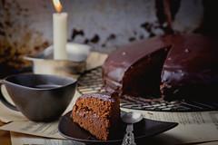 Sachertorte. (Zoryanchik) Tags: birthday food brown cake dark pie table dessert wooden sweet chocolate cream tasty plate delicious eat glaze slice bakery snack pastry brownie piece garnish austrian torte sacher