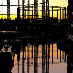 Gas Light (No Great Hurry) Tags: cmwdyellow reflection iron castiron structuralengineering industrial gasholder gas urbanarte sunset orange water reflections barge narrowboat canalboat regentscanal silhouette eastlondon gasometer 1000views 1000 ngh robinmauricebarr amateur amateurphotographer robinmauricebarralsoknownasnogreathurry art photoart london capital uk britain gb greatbritain lndn england square squared cube robinbarr photo image photographic 2000 2000views squareformat exposure flickr unitedkingdom nogreathurry linesandcurves lines curves