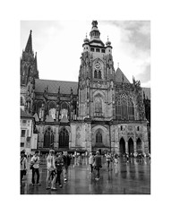 The city of a hundred spires LXII (2 Marvelous 4 Words) Tags: windows people bw reflection wet rain architecture facade arquitectura prague cathedral bricks catedral czechrepublic raining stvituscathedral praguecastle frenchgothicstructure