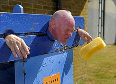 100710.015. 'Splatt Adrian'. (actionsnaps) Tags: man water kent adult spray stocks familyfun splash captive highstreet fundraising throwing eyesshut baldhead thanet restrained redface charityevent communityevent pillory garlinge closeeyes policecommunitysupportofficer kentpolice wetsponges garlingeresidentsassaciationsummerfair garlingemethodistchurch splattadrian pcsoadrianbutterworth
