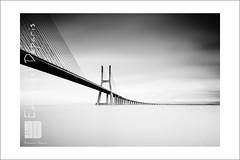 "bridge 'the suspended road"" (Emmanuel DEPARIS) Tags: road bridge sea white black beach portugal river nikon lisboa 110 ponte filter lee nd vasco emmanuel lisbonne deparis"