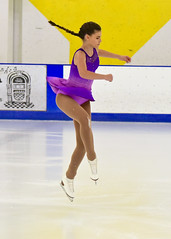 spinning leap... (R.A. Killmer) Tags: skill smile skate ice show style graceful beauty leap spin purple performer performance girl