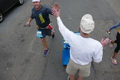 San Francisco Marathon Cheerleader Gives High Five to Happy-ish Runner (Lynn Friedman) Tags: 94117 lynnfriedman sanfrancisco marathon runners encourangement acknowledgment highfive fashion