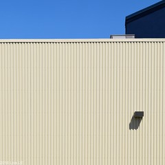 Urban Abstraction (llawsonellis) Tags: sky blue emptiness mundane city urban space colours structure wall building shadow pattern minimalism abstraction fragment linear rectilinear corrugatedsteel steel minimalist cream navy nikon sqaure rectangle rectangles urbanscape simple lessismore architecture fascade