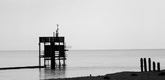 The Watch Tower (flosspot) Tags: shoreline sea silhouettes water frame bw blackandwhite lynettecoates sony watchtower