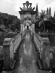 a royal bridge (SM Tham) Tags: asia indonesia bali island karangasem amlapura tamanujong waterpalace watergardens gardenstosee bridge balustrades archways perspective vista blackandwhite monochrome outdoors trees water pond wet