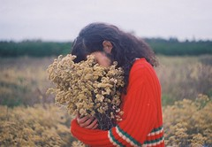 (Hijo de la Tierra.) Tags: film analog 35mm grain analogue marcela flower flowers boy red longhair curl young countryside lifestyle nature autumn memories feelings cold uruguay