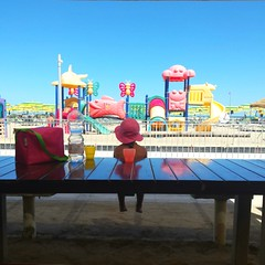 Wanderer in front of playground (Jessica Bizzoni) Tags: rimini italy beach kidsarealright colours sea sky playground summer wanderer girl