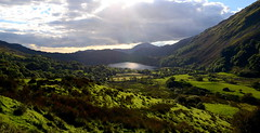 Nant Gwynant (Peter.S.Roberts) Tags: interestingness interesting nant gwynant nantgwynant northwales valley hillside landscape wales cymru nature trees water snowdonia grasses llyn lake sun shadows reflections autumn mountainrange roman historic beautiful complete llyngwynant view scene scenic route breathtaking traveling quiet serene peaceful relaxing historicroute undisturbed colours ineffable stunning pov dof nikond7000 viewpoint extreme october calm afon shrubland scrubland