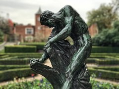 Leaning Man (DanCupples) Tags: blue statue plants bushes amateurphotographer hollandpark kensingtonandchelsea london iphone iphone7plus
