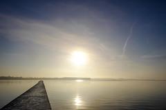Sunrise on the lake (Wouter de Bruijn) Tags: fujifilm xt1 fujinonxf14mmf28r sunrise dawn morning mist fog haze lake water jetty pier calm weather clouds landscape outdoor glow
