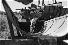 even flow (.sanden.) Tags: wood arizona bw white black water phoenix metal flow gold action az panning 2470mm canon40d