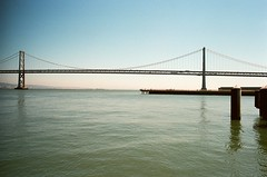 41770024 (september.) Tags: sanfrancisco california bridge blue summer sky film water 35mm pacific sunny clear baybridge ferrybuilding sanfranciscobay canonae1 ferryterminal theembarcadero canonfd kodakportra400 sanfranciscooaklandbaybridge canonfd28mmf28