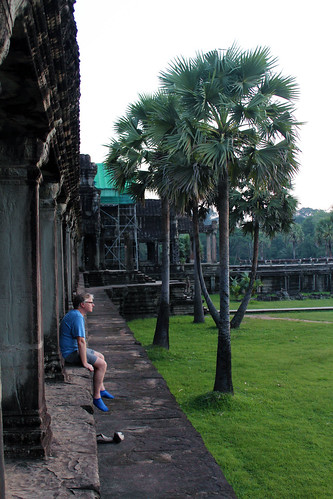 A tourist enjoying the beauty of Angkor Wat temple (Chetra Chap, 2012).