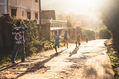 Kids running through the streets of Ambositra.