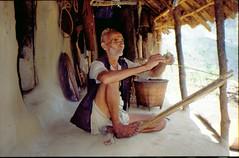 Brahmin making a rope (spring 1990) (gbohne) Tags: nepal traditional rope explore hanf hemp handwerk brahmin seiler ropemaker bahundanda explored brahmane cordmaker seilerei geo:country=nepal geo:region=asia