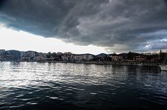 Dark clouds over the port (of Lavrio) (kutruvis nick) Tags: houses sea sky reflection water clouds port buildings dark greek nikon harbour hellas overcast greece nik lavrio attiki d5100 lavreotiki kutruvis
