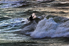 surfing (Lior. L) Tags: light sea water silhouette canon israel waves shadows seascapes surfer surfing rough canondslr canon70200f4l roughsea hertzelia hertzeliabeach canon600d canont3i canonkiss5