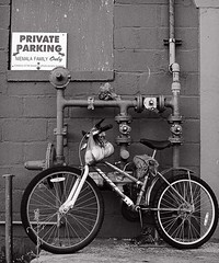 Private parking (TwinCitiesSeen) Tags: grandrapids minnesota twincitiesseen canont3i tamron2875mm blackandwhite bicycle