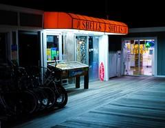 She sells seashells. (instant_Focus) Tags: night boardwalk ocean pier atmosphere fujifilm
