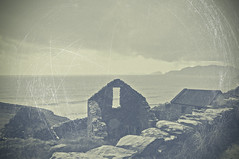 There was still an hour or two of daylight - even though clouds admitted only a greyish light upon the world... (Paulina_77) Tags: vintage mood atmosphere ireland dingle peninsula scratches scratched gloomy dismal gray sky clouds water ocean sea ruins castle coast nikkor18105mm nikkor 18105mm 18105 nikkor18105mmf3556 18105mmf3556 nikond90 nikon d90 pola77 elusive ethereal ethereality wistful melancholy melancholic faded dim pale moody atmospheric dreamy dream daydream black white bw blackandwhite monochrome mono grayscale monochromatic muted tones fence hff irish landscape seascape ringofkerry kerry atlantic north seaside house scenery forsaken abandoned deserted travel islands texture