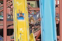 Fast and Wet Way Down (aaronrhawkins) Tags: sevenpeaks waterpark provo utah summer swimming swim swimsuit boy joshua bright slide tower pipes stairs crowd fun sunny colors speed fast splash aaronhawkins waterslide 7peaks wet