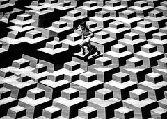 Deconstruction (Petricor Photography) Tags: milan milano street photography black white blackandwhite abstract canonpersonalconnection candid child playing jumping museum pattern fuji xt1