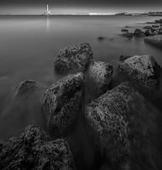 Chania Harbour Crete (ANG Imagery) Tags: blackandwhite 10stopfilter longexposure seascape water lighthouse texture rocks still calm dawn fineart crete monochrome