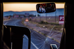 Drive on you crazy driver (Melissa Maples) Tags: aksaray turkey trkiye asia  nikon d5100   nikkor afs 18200mm f3556g 18200mmf3556g vr dawn morning window coach bus windscreen windshield cracked cracks driver reflection mirror driving road trkiye