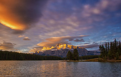 A New Dawn (SandyK29) Tags: twojacklake sunrise dawn sunglow mountain mountrundle banff alberta canada canadianrockies purple pink lake trees firs pines water clouds sky bluesky peaceful serene nature beautyinnature beauty morning fall sun glowingmountain otherworldly nikond800