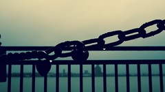 Chains. (elam2010) Tags: waterfront chains rain raindrops padlock misty rivermersey liverpool birkenhead morning moody silhouettes olympus penf