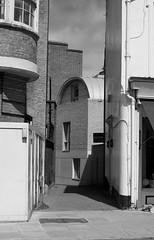 Something new tucked behind something old (IanAWood) Tags: london streetphotography knightsbridge urbanlife summerinthecity walkingwithmynikon nikondf nikkorafs58mmf14g